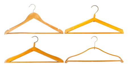 coat hanger: Four wooden hangers isolated on white background