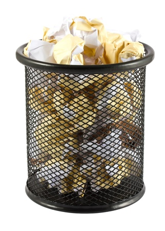 Garbage bin with crumpled paper isolated on white background