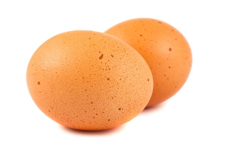 yolk: Two brown eggs isolated on white background