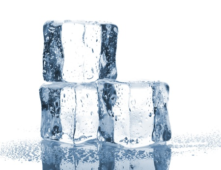 frozen solid: Three ice cubes with water drops isolated on white background