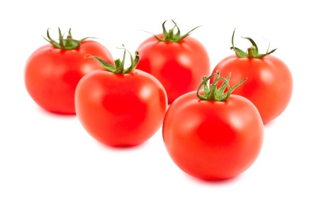 Five ripe tomatoes isolated on white background photo