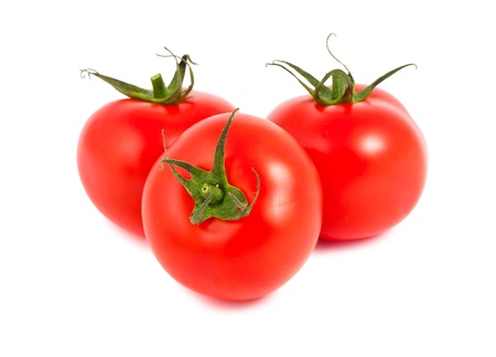 Three ripe tomatoes isolated on white background photo