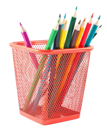 Colorful pencils in red holder isolated on white background  photo