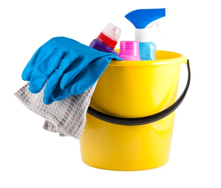 Yellow bucket with cleaning supplies isolated on white background