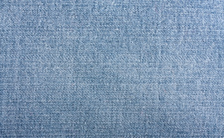 worn structure: Blue jeans fabric texture may be used as background