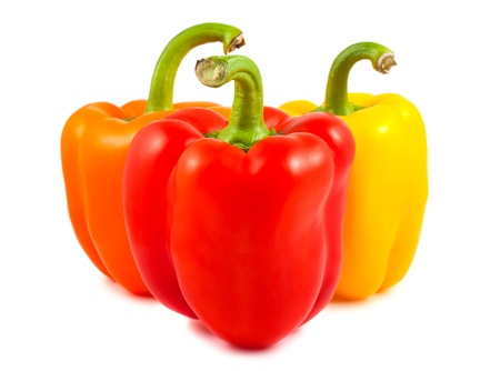 red peppers: Orange, red and yellow peppers isolated on white background Stock Photo