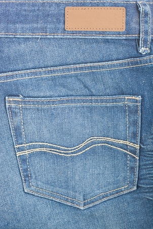 Close up of blue denim with pocket and label  photo