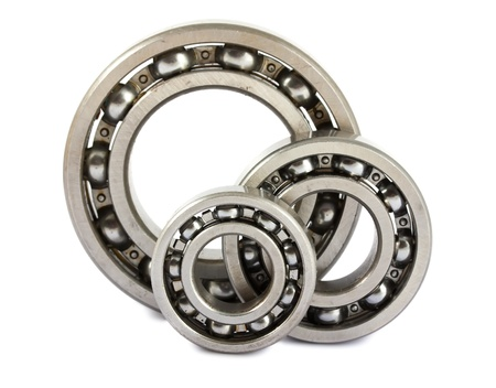 Three ball bearings isolated on white background photo