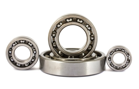 Four ball bearings isolated on white background photo
