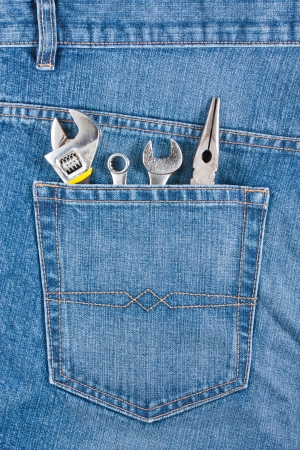 Several tools on a blue jeans pocket photo