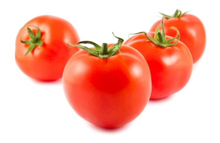 Four ripe tomatoes isolated on white background Stock Photo - 13976465