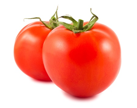 Two ripe red tomatoes isolated on white background photo