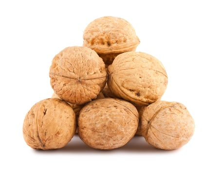 hardiness: Heap of ripe walnuts isolated on white background