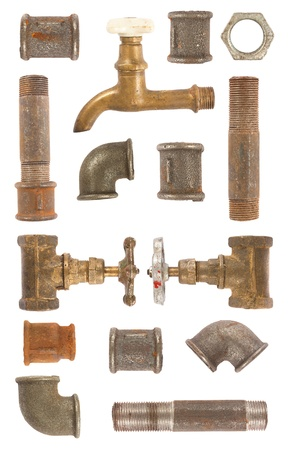 Used water pipes, valves and connectors collection on white background photo