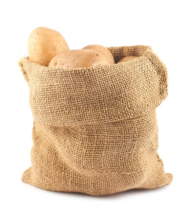 Raw potatoes in burlap sack isolated on white background Banco de Imagens