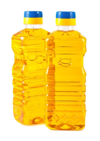 Two plastic bottles with vegetable oil isolated on a white background photo