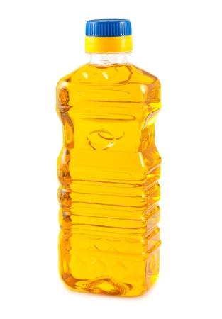 Vegetable oil in plastic bottle isolated on white background