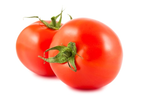 Two red ripe tomatoes isolated on white background photo