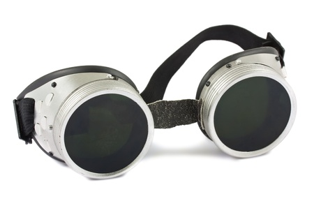 Old used welding goggles isolated on white background photo