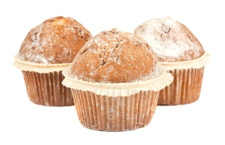 Three muffins isolated on white background photo