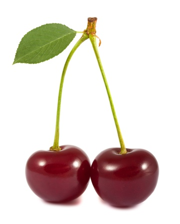 Pair of red cherries with green leaf isolated on white background photo