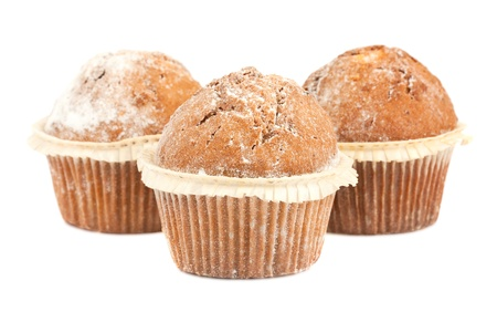 Three fresh muffins isolated on white background photo