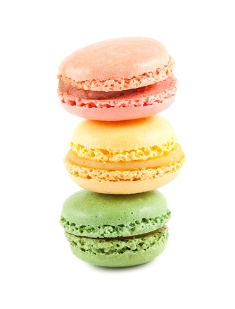 Stack of colorful macaroons on the white background photo
