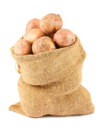 earthy: Ripe potatoes in burlap sack isolated on white background Stock Photo