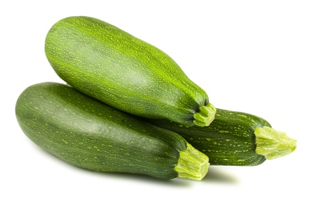 marrow squash: Three fresh green zucchini isolated on white background