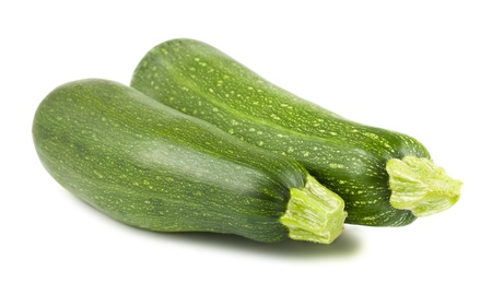 vegetable marrow: Pair of fresh green zucchini isolated on white background Stock Photo