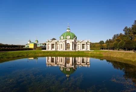 kuskovo: The Grotto Pavilion with reflection in water at the museum-estate Kuskovo, Moscow, Russia