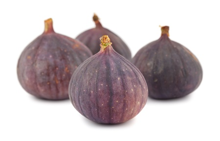 purple fig: Four whole purple fig fruits isolated on white background