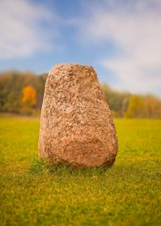 granite park: Big granite rock lying on a green grass