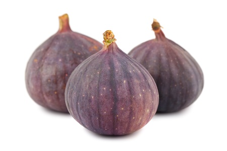 Ripe purple fig fruits isolated on white background photo