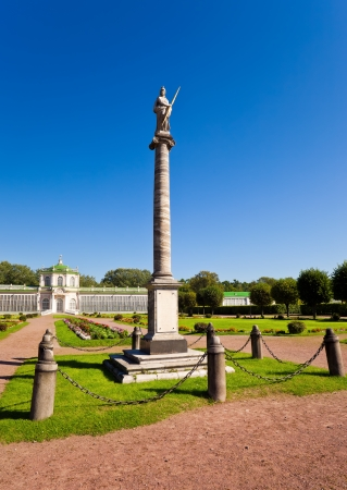 Colonna with a statue of Minerva against the greenhouse  Kuskovo estate, Moscow, Russia
