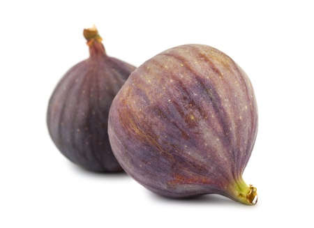 purple fig: Pair of ripe purple fig fruits isolated on white background Stock Photo