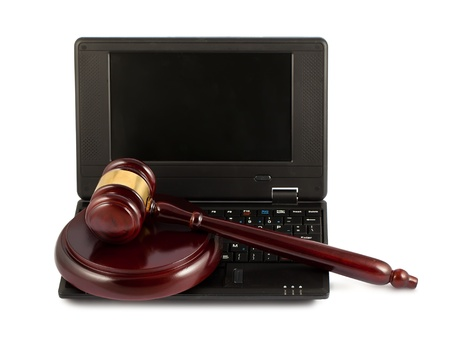 Judges wooden gavel on a black laptop computer keyboard Stock Photo - 16417495