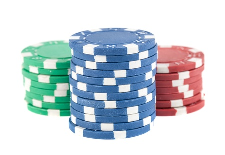 Three stacks of poker chips isolated on white background photo