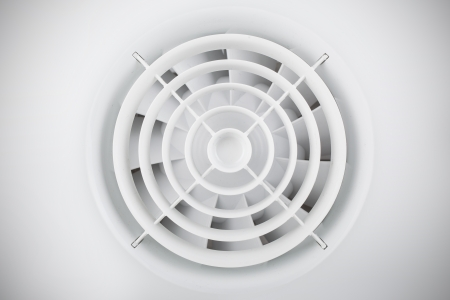 Round white plastic grille with air fan photo