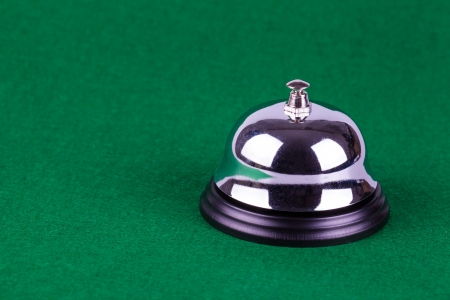 Silver alarm service bell on green background Stock Photo - 17478244