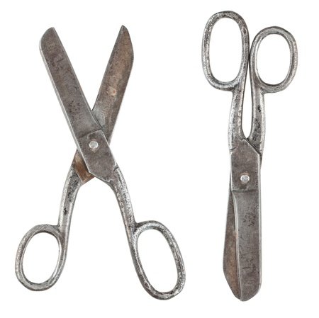 Rusty tailor scissors in closed and opened form isolated on white background photo