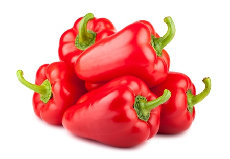 Heap of red sweet pepper isolated on white background photo