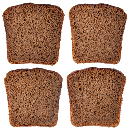 Different slice of black rye bread isolated on white background photo