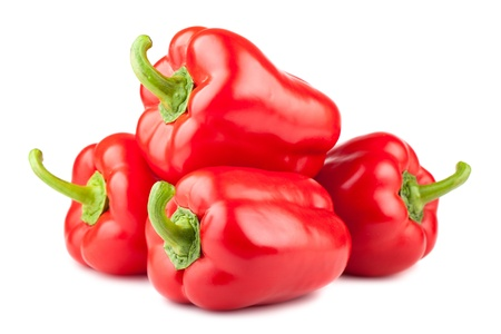 capsicums: Heap of red sweet pepper isolated on white background