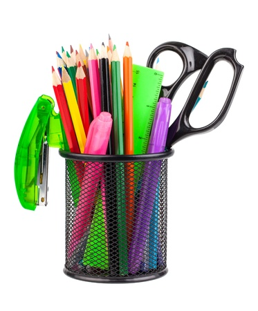 Office cup with scissors, pencils and pens isolated on white background photo