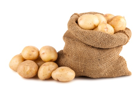 Sack of ripe potatoes isolated on white background