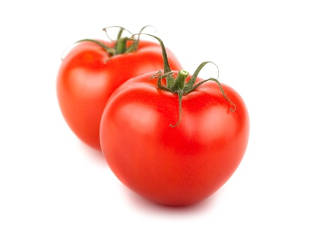 Pair of ripe red tomatoes isolated on white background Stock Photo - 20301576
