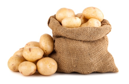 Ripe potato in burlap sack isolated on white background Banco de Imagens