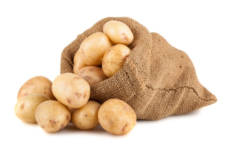 Ripe potato in burlap sack isolated on white background Imagens