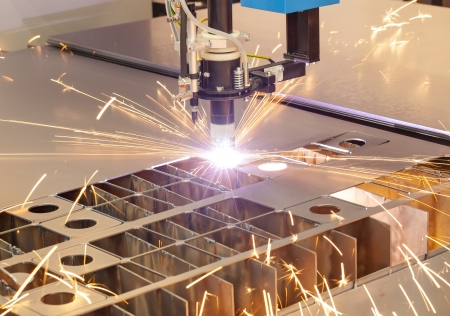 laser cutting: Plasma cutting metalwork industry machine with sparks Stock Photo